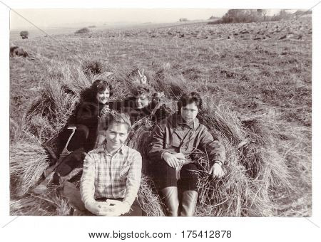 VITEBSK BELARUS - SEPTEMBER 1988: Students of Vitebsk medical institute on seasonal agricultural work in collective farm (harvesting of flax) group photograph (vintage black and white photo 1988)