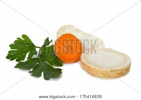 Carrot parsley and celery slices isolated on white background