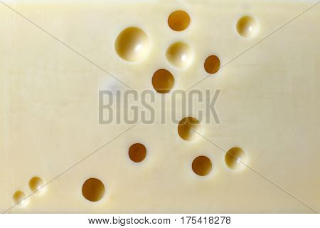 Horizontal image of emmental cheese  with holes