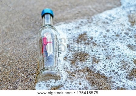 Message in the bottle on sandy beach