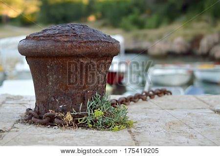 Close up of old rusty boat bollard