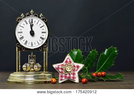 Christmas card with vintage clock and Christmas star ornament