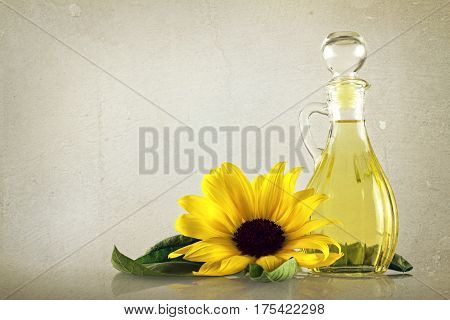 Sunflower oil in a decanter on grunge background