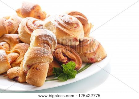 Sweet buns with jam on a white background