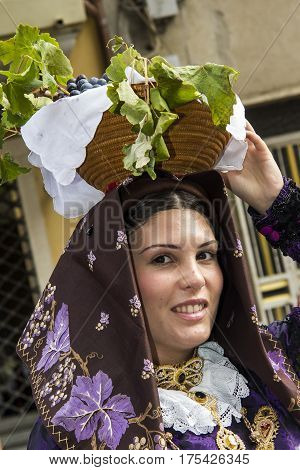 QUARTU S.E., ITALY - September 15, 2013: Wine Festival in honor of the celebration of St. Helena - itratto of a beautiful girl in traditional Sardinian costumes of the folk group