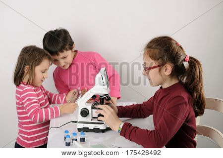 three little girls studying