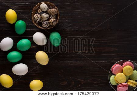 Paschal eggs on rustic, wood table. Top view. Copy space