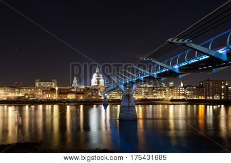 St. Paul's cathedral and the Millennium bridge at night, London, UK