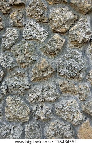 wall of stone between the stone visible cement