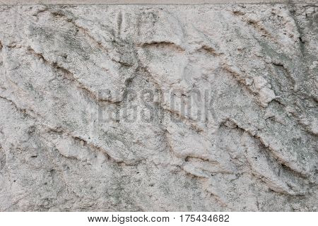 the background of the old decorative plaster covered with dirt and bolt