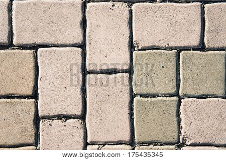 Seamless tileable texture pavement brick paving stones on a sidewalk
