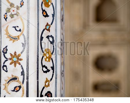 A detail of the beautiful intricate inlay pattern decorating the Agra Fort in India.
