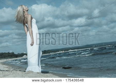 Young Lady Resting On Beach.