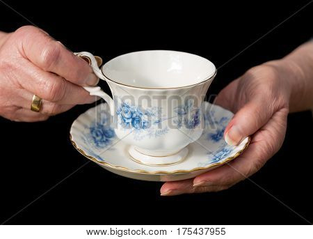 Traditional Teacup And Saucer Held In English Lady's Hands.