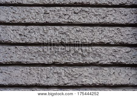 Texture of decorative gray plaster wall surface