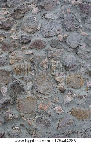 Texture of smooth gray stone wall surface