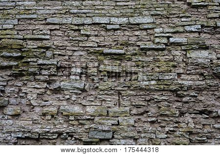 Texture of old jagged gray stone wall