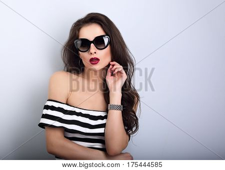 Chic Female Model With Long Hair Posing In Fashion Sunglasses In Striped Dress With Hand In Bangle N