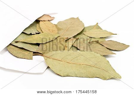Bay leaves in white paper bag isolated on white