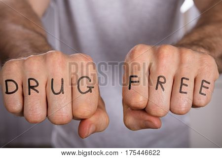 Close-up Of A Person Showing Drug Free Concept On Fist