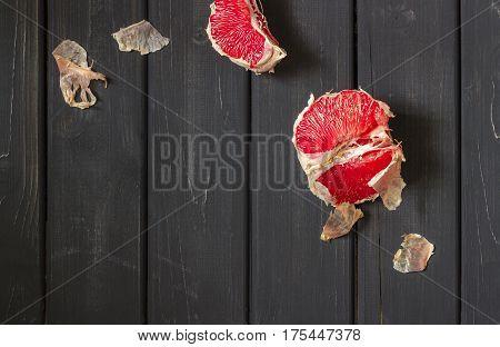 Fresh Grapefruits On Dark Wooden Background