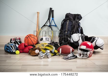 Photo Of Various Sport Equipments On Hardwood Floor