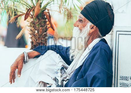 Amritsar, India - AUGUST 15:  Portrait of an Old Sikh sitting at Golden Temple (Harmandir Sahib) on August 15, 2016 in Amritsar, Panjab, India.