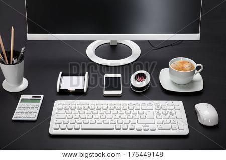Close-up Of A Computer Desk With Stationary Equipment