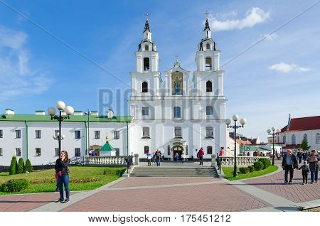 MINSK BELARUS - OCTOBER 1 2016: Unknown people walk near Cathedral of Descent of Holy Spirit (Holy Spirit Cathedral) Minsk Belarus