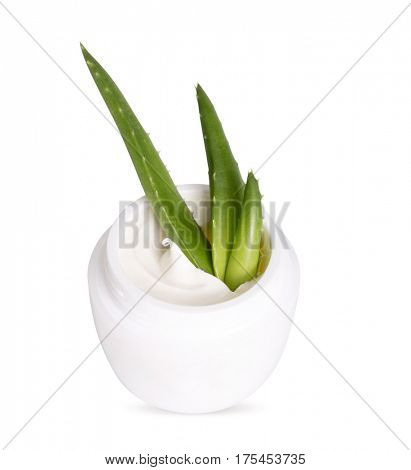 Jar with cosmetic cream and leaves of aloe vera. Isolated on white background
