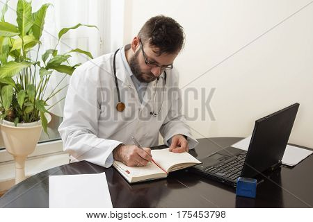 A doctor in a white coat entered something into your calendar pen.