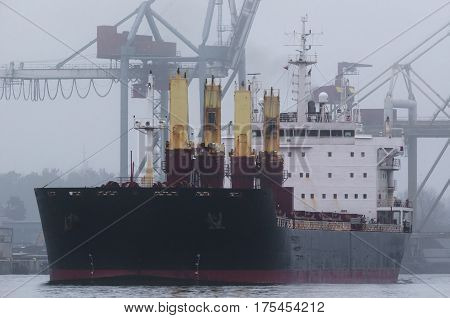 MERCHANT VESSEL - ship sets sail from the port in mist