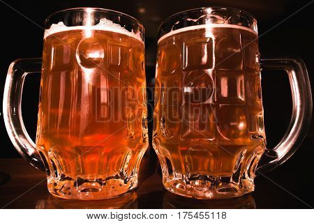 Beer. Two cold beers. Draft beer. Draft ale. Golden beer. Draft cold beer in glass jars in home pub hotel or restaurant. Still life.