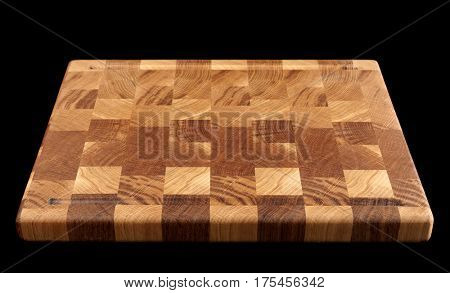 Wooden cutting board isolated on black background