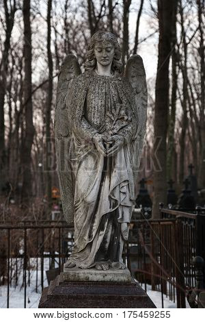 MOSCOW, RUSSIA - MAR 8, 2017: German cemetery(Vvedenskoye cemetery) is a historical cemetery in the Lefortovo district of Moscow. The cemetery was founded in 1771. Girl statue-angel with wings