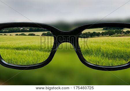 Clear vision through lenses of black framed eyeglasses