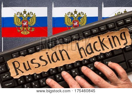 Russian hacking inscription on torn paper sheet. Russia hacking concept