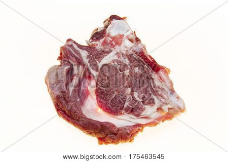 Lamb slices closeup. Australian lamb . Part of the carcass of a sheep saddle on the bone. Fresh meat with streaks of fat