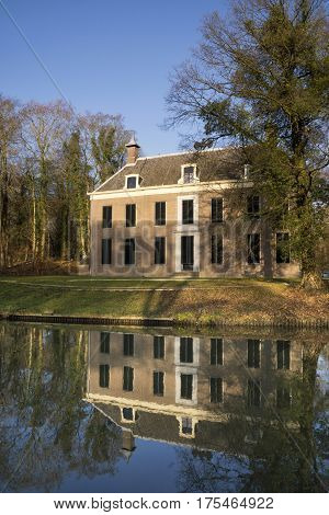 The manorial estate Oud-Amelisweerd on the banks of the river Kromme Rijn near Bunnik