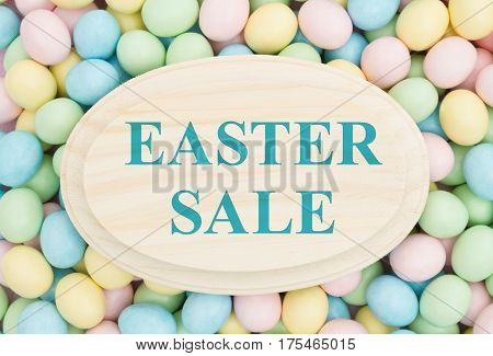 An ad for an Easter sale Retro Easter eggs candy on wood plaque with text Easter Sale