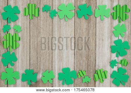 Saint Patrick's Day background Green shamrocks on weathered wood background