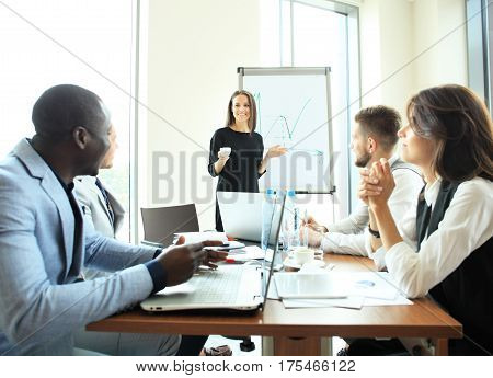 Woman making a business presentation to a group