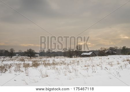 Radioactive winter landscape near Chernobyl with abandoned farms and houses in the death-zone in the Ukraine.