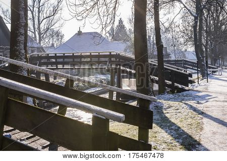 Giethoorn The Netherlands - January 18 2016: Winterlandscape with canal farmhouse and several bridges in the typical dutch village of Giethoorn in the province of Overijssel in the Netherlands.
