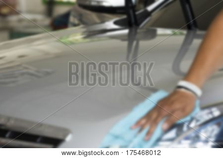 Blurry image Man was wiping car with hand and microfiber cloth Car cleaning Car washing