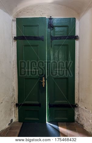 Dornburg Germany - July 23 2016: Open door of a church in Dornburg (Saale) in Germany with a sunbeam coming in.