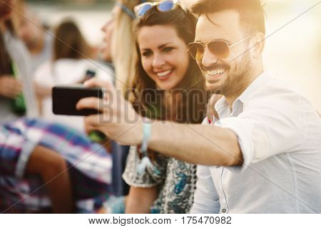 Young happy group of friends having fun outdoors and enjoying life