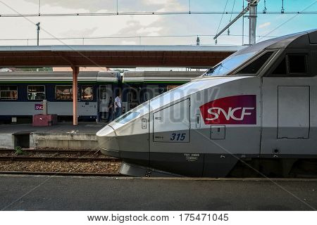LOURDES FRANCE - AUGUST 22 2006: French High Speed train TGV Atlantique ready for departure on Lourdes station platform. An overnight train can be seen in the background