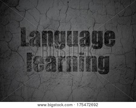 Learning concept: Black Language Learning on grunge textured concrete wall background