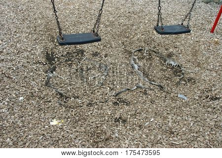 Park Swings With Damaged Safety Surface